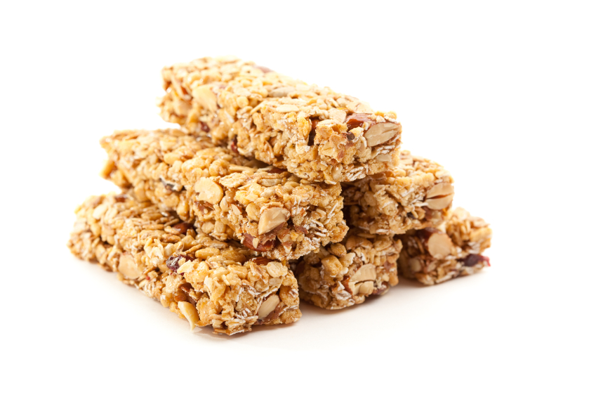 Stacked Granola Bars Isolated on a White Background with Narrow Depth of Field.